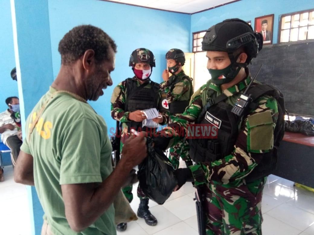 Peduli Sesama, Satgas Pamtas RI-PNG Yonif Raider 100 /PS Gelar Bansos & Pelayanan Kepada Masyarakat
